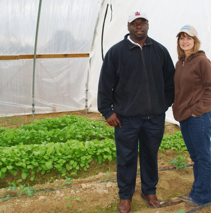 (l-r) Landowner Tim Strong and Wendy Smith in hoop house.
