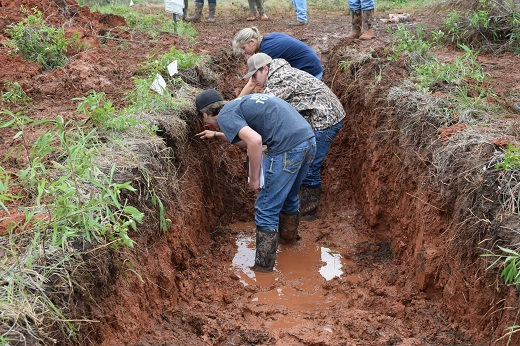 Land judging contestants use pocket knives to determine topsoil depth in a practice pit at the Lake Arcadia Conservation Education Area in Edmond, Oklahoma. The contest has been held every year for 65 years despite blistering heat, rain, ice and tornadoes.