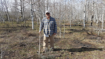 Rob Fitzgerald standing in front of birch trees