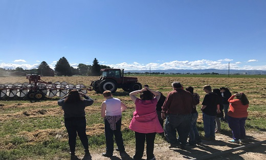 Students return to Dixon's farm in June of 2019 and learn how the hay rake and baler work as well as see young crops growing.