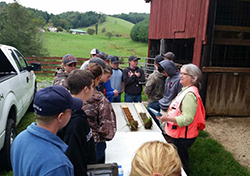 NRCS Resource Soil Scientist Jeannine Freyman uses a soil profile to highlight differences in soil types and their suitability for agriculture and other uses at a workshop on the New River Hill Farm.