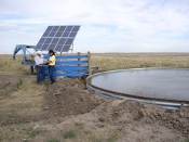 Producer, Bill Whiting, and NRCS Tribal Liaison, Mary Scott discussing the solar panel system