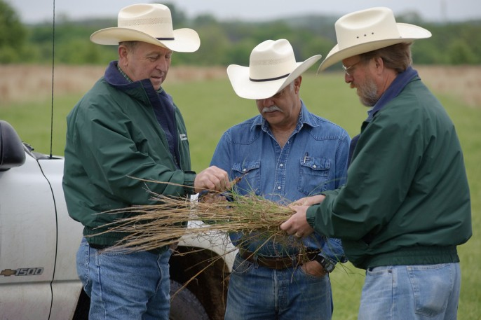 Range Management Specialists discuss ranch goals with a customer